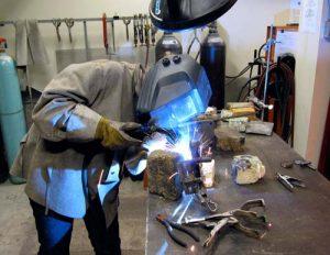 Student welding in the workshop